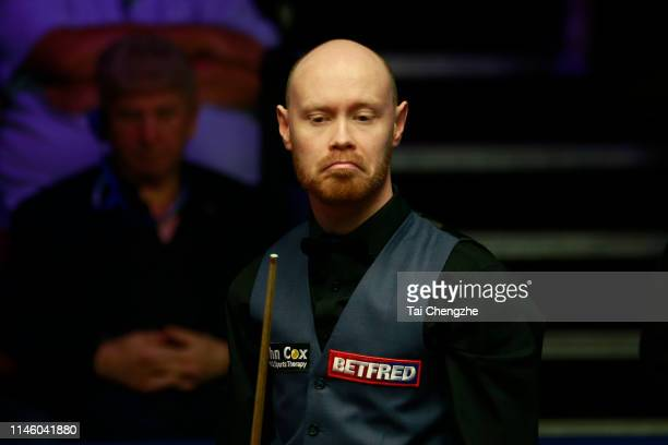 Gary Wilson of England reacts in the quarterfinal match against Ali Carter of England on day eleven of the 2019 Betfred World Snooker Championship at...