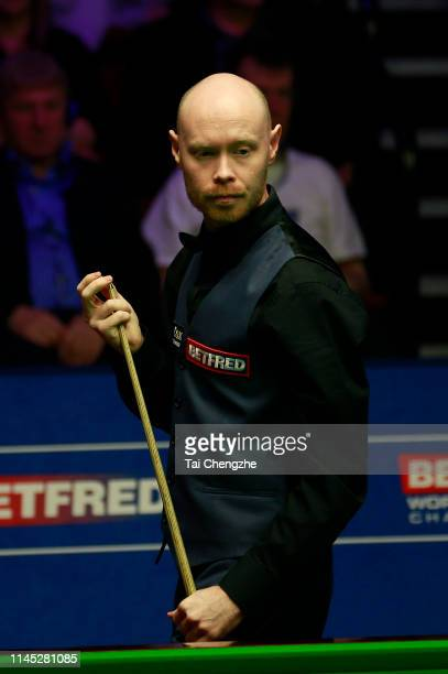 Gary Wilson of England reacts in the second round match against Mark Selby of England during day seven of the 2019 Betfred World Snooker Championship...