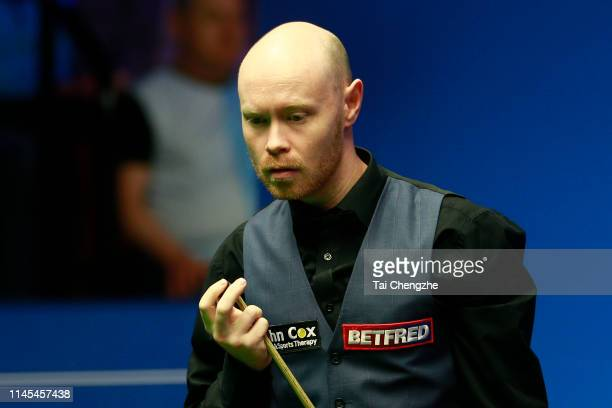 Gary Wilson of England reacts in the second round match against Mark Selby of England during day eight of the 2019 Betfred World Snooker Championship...