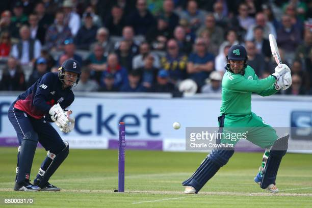 Gary Wilson of Ireland hits out as Sam Billings England wicket keeper looks on during the Royal London ODI between England and Ireland at Lord's...