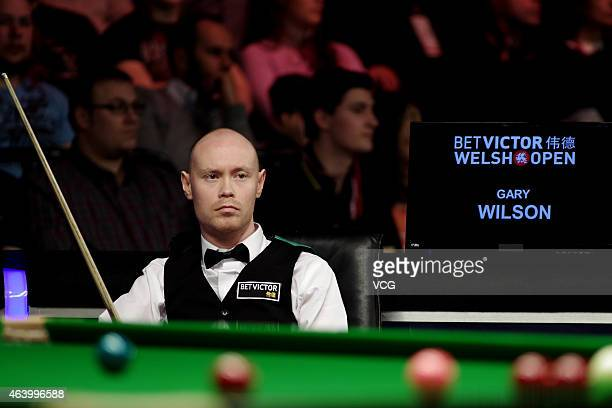 Gary Wilson of Scotland reacts against Ben Woolaston of England during day five of 2015 BetVictor Welsh Open at Motorpoint Arena on February 20 2015...
