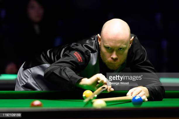 Gary Wilson plays a shot during his match against Nigel Bond in the fourth round of the Betway UK Championship at The Barbican on December 05, 2019...