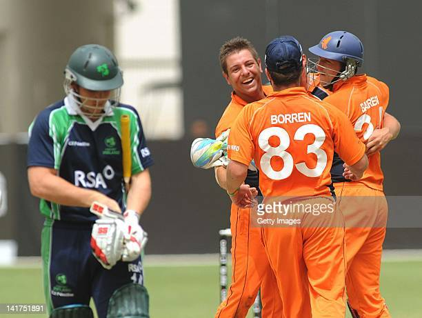 Gary Wilson shows his dejection as Peter Borren of the Netherlands and team mates celebrate during the ICC World Twenty20 Qualifier Preliminary Final...