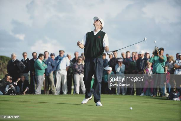 Gary Wolstenholme of the Great Britain and Ireland team just misses a putt in his match against Tiger Woods during the Walker Cup at Royal Porthcawl...