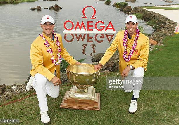 Gary Woodland and Matt Kuchar of USA celebrate with the trophy after winning the foursomes on the final day of the Omega Mission Hills World Cup at...