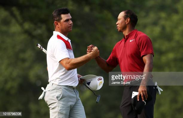 Gary Woodland and Tiger Woods of the United States shake hands after finishing on the 18th green during the final round of the 2018 PGA Championship...