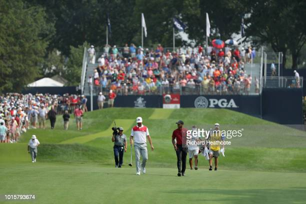 Gary Woodland and Tiger Woods of the United States walk on the tenth hole during the final round of the 2018 PGA Championship at Bellerive Country...