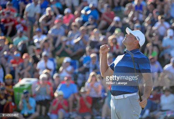 Gary Woodland celebrates after making a par to beat Chez Reavie in a playoff during the final round of the Waste Management Phoenix Open at TPC...