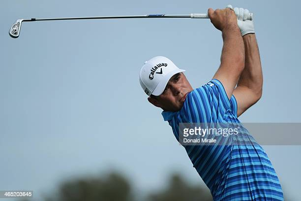 Gary Woodland hits a tee shot on the 2nd hole during the final round of the Farmers Insurance Open on Torrey Pines South on January 26, 2014 in La...