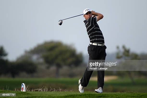 Gary Woodland hits a tee shot on the 9th hole during the first round of the Farmers Insurance Open on Torrey Pines North on January 23 2014 in La...