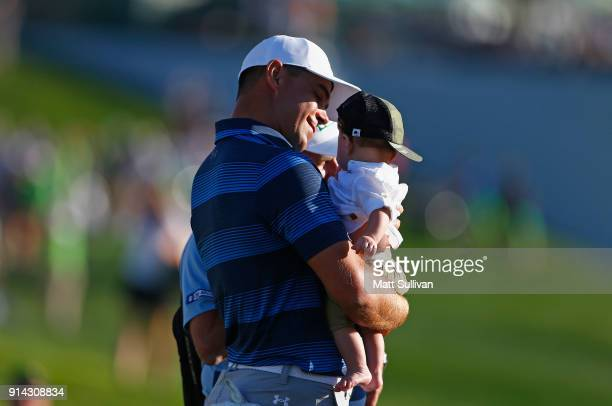 Gary Woodland holds his son Jaxson after winning the Waste Management Phoenix Open at TPC Scottsdale on February 4 2018 in Scottsdale Arizona