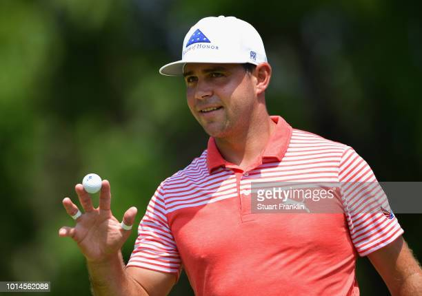 Gary Woodland of the United States acknowledges the crowd after making a par on the ninth green during the second round of the 2018 PGA Championship...