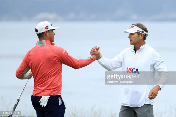 Gary Woodland of the United States and caddie Brennan Little celebrate on the 18th green after winning the 2019 US Open at Pebble Beach Golf Links on...