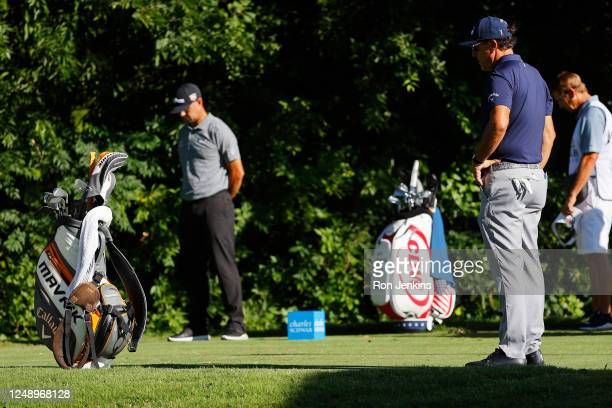Gary Woodland of the United States and Phil Mickelson of the United States take part in a moment of silence in place of the 8:46 tee time to honor...