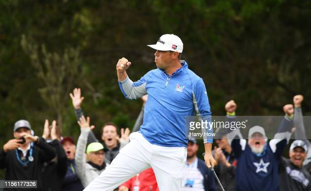 Gary Woodland of the United States celebrates a parsaving putt on the 12th green during the third round of the 2019 US Open at Pebble Beach Golf...