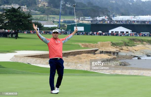 Gary Woodland of the United States celebrates holing a long birdie putt on the 18th green to secure his three shot victory in the final round of the...