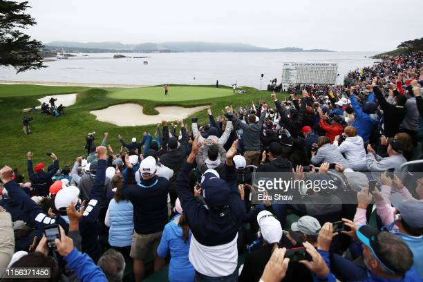 Gary Woodland of the United States celebrates on the 18th green after winning the 2019 U.S. Open at Pebble Beach Golf Links on June 16, 2019 in...