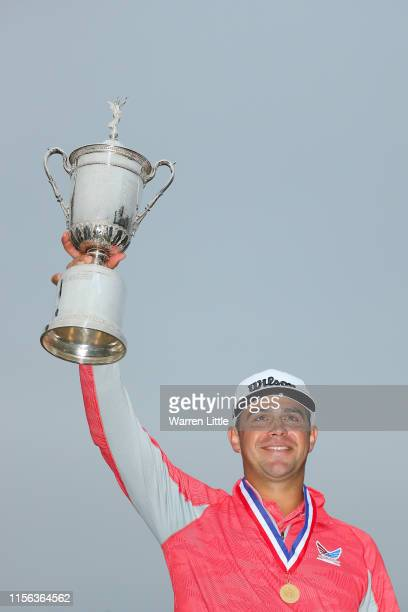 Gary Woodland of the United States celebrates with the trophy after winning the 2019 US Open at Pebble Beach Golf Links on June 16 2019 in Pebble...