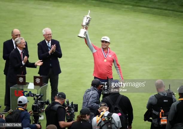 Gary Woodland of the United States celebrates with the trophy after winning the 2019 U.S. Open at Pebble Beach Golf Links on June 16, 2019 in Pebble...