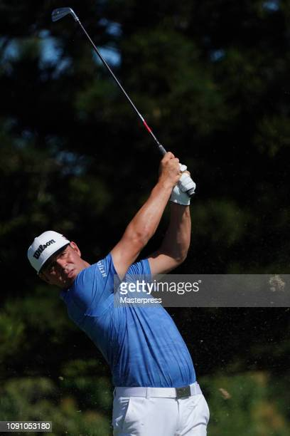Gary Woodland of the United States hits a tee shot on the 2nd hole during the final round of the Sentry Tournament of Champions at the Plantation...