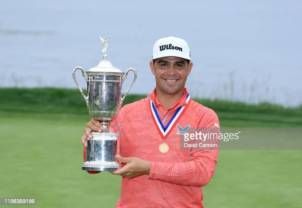 Gary Woodland of the United States holds the USOpen trophy after his three shot victory in the final round of the 2019 USOpen Championship at the...