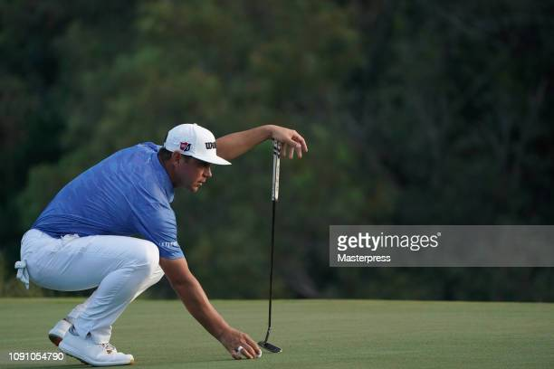 Gary Woodland of the United States lines up for a putt on the 18th green during the final round of the Sentry Tournament of Champions at the...