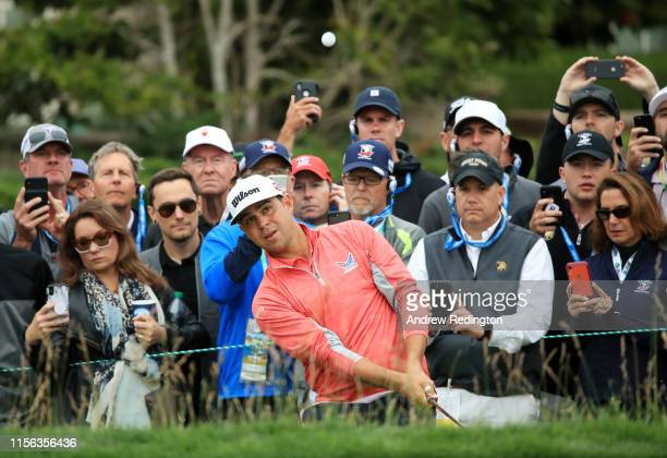 Gary Woodland of the United States plays a second shot on the 12th hole during the final round of the 2019 US Open at Pebble Beach Golf Links on June...