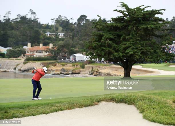 Gary Woodland of the United States plays a second shot on the 18th hole during the final round of the 2019 US Open at Pebble Beach Golf Links on June...