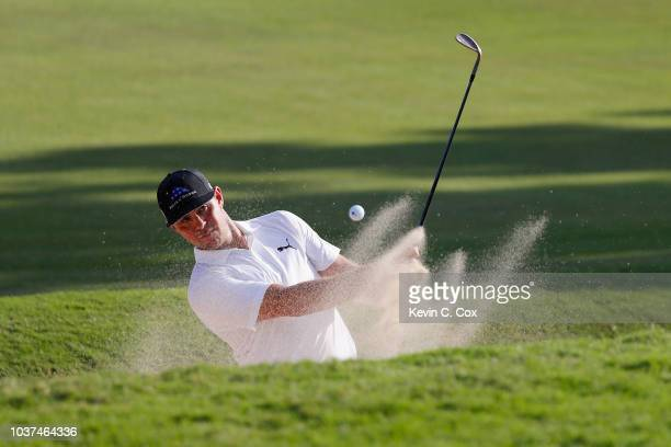 Gary Woodland of the United States plays a shot from a bunker on the 17th hole during the second round of the TOUR Championship at East Lake Golf...