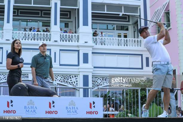 Gary Woodland of the United States plays a shot watched by Jordan Spieth and Henni Zuel during the 'Hero Shot at Baha Mar' held at the Baha Mar...
