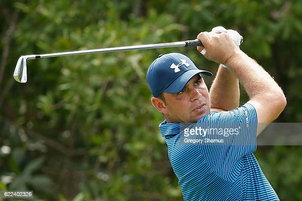 Gary Woodland of the United States plays his shot from the 17th tee during the second round of the OHL Classic at Mayakoba on November 11 2016 in...