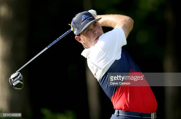 Gary Woodland of the United States plays his tee shot on the 17th hole during the first round of the 100th PGA Championship at the Bellerive Country...