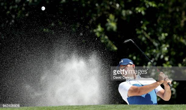 Gary Woodland of the United States plays his third shot from a bunker on the fifth hole during the first round of the 2018 Masters Tournament at...