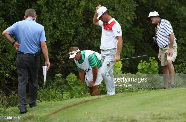 Gary Woodland of the United States prepares to play a shot on the 17th hole during the final round of the 2018 PGA Championship at Bellerive Country...