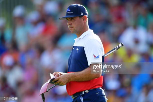 Gary Woodland of the United States stands on the 18th hole during the first round of the 2018 PGA Championship at Bellerive Country Club on August 9...