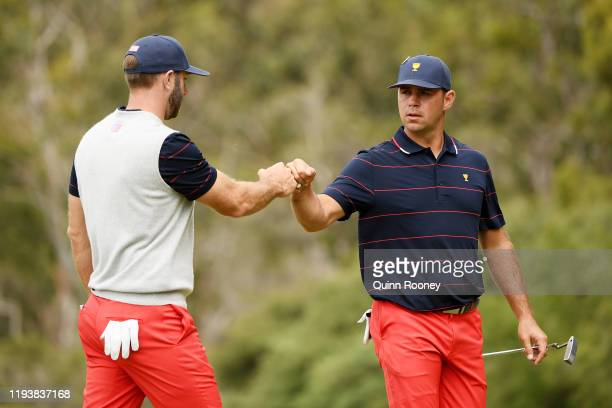 Gary Woodland of the United States team and Dustin Johnson of the United States team celebrate during Saturday afternoon foursomes matches on day...