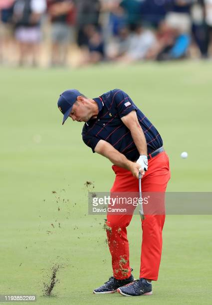 Gary Woodland of the United States Team plays his second shot on the 15th hole in his match with Dustin Johnson in their match against Adam Scott and...
