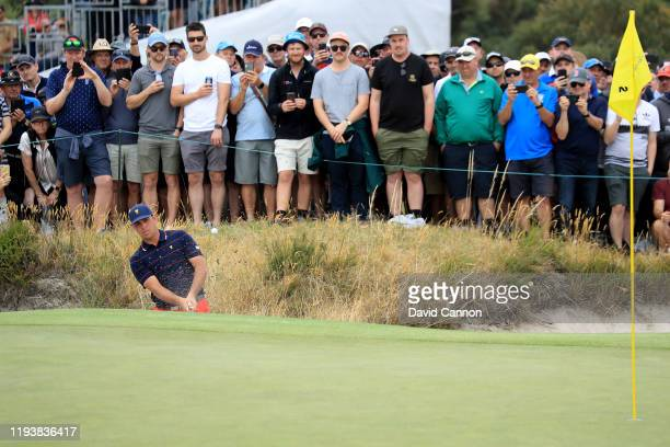 Gary Woodland of the United States Team plays his third shot on the second hole in his match with Dustin Johnson in their match against Adam Scott...