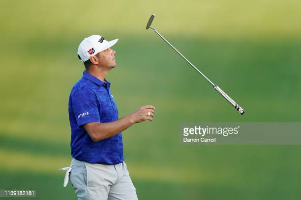 Gary Woodland of the United States tosses his putter in his match against Justin Rose of England during the third round of the World Golf...