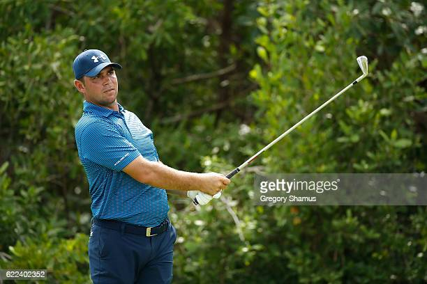 Gary Woodland of the United States watches his shot from the 17th tee during the second round of the OHL Classic at Mayakoba on November 11 2016 in...
