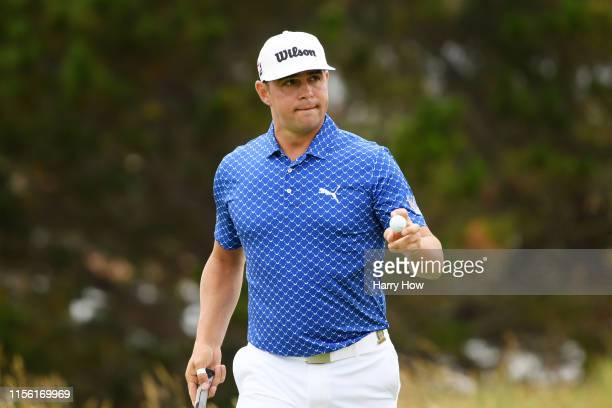 Gary Woodland of the United States waves after a birdie on the fourth green during the third round of the 2019 US Open at Pebble Beach Golf Links on...