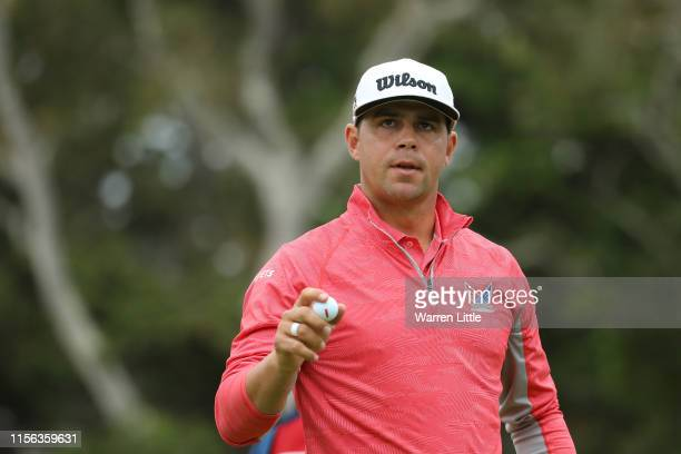 Gary Woodland of the United States waves on the 16th green during the final round of the 2019 US Open at Pebble Beach Golf Links on June 16 2019 in...