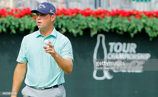 Gary Woodland of the United States waves to the gallery on the 18th hole after shooting a sevenunder par 63 during the third round of the TOUR...