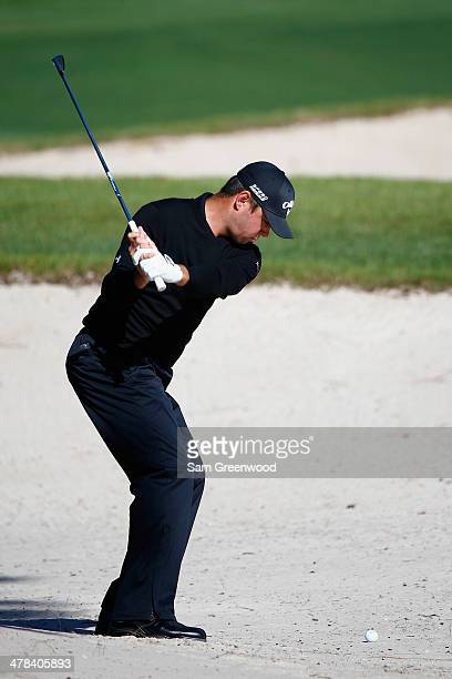 Gary Woodland plays a shot on the 18th hole during the first round of the Valspar Championship at Innisbrook Resort and Golf Club on March 13 2014 in...