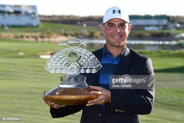 Gary Woodland poses with the tournament trophy after winning the Waste Management Phoenix Open at TPC Scottsdale on February 4 2018 in Scottsdale...