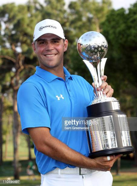 Gary Woodland poses with the trophy after winning the Transitions Championship at Innisbrook Resort and Golf Club on March 20, 2011 in Palm Harbor,...