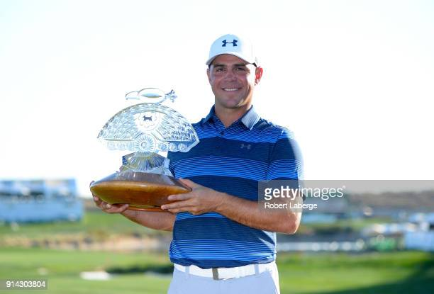 Gary Woodland poses with the trophy after winning the Waste Management Phoenix Open at TPC Scottsdale on February 4 2018 in Scottsdale Arizona