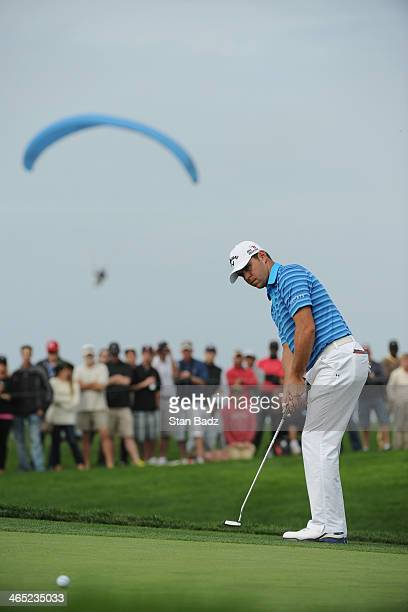 Gary Woodland putts on the 5th green during the final round of the Farmers Insurance Open on Torrey Pines South on January 26, 2014 in La Jolla,...