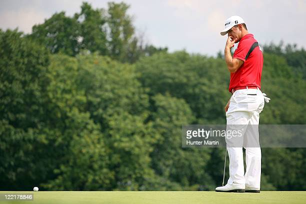 Gary Woodland reacts after he missed a birdie putt attempt on the 18th hole green during round two of The Barclays at Plainfield Country Club on...