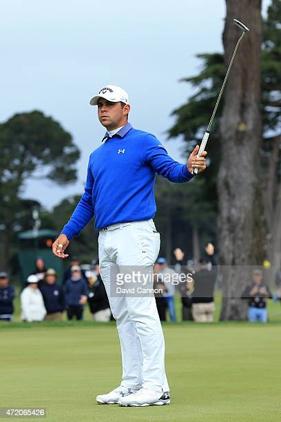 Gary Woodland reacts after making a birdie putt on the 16th hole green to win his semi final match 32 over Danny Willett of England in the World Golf...